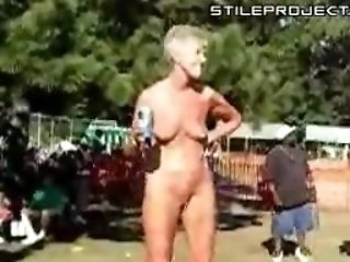Naked Granny Chilling Out Naked At An Outdoor Festival