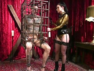 Veruca James Tantalizes Her Sub With A Ball Gag And A Strap On Dildo